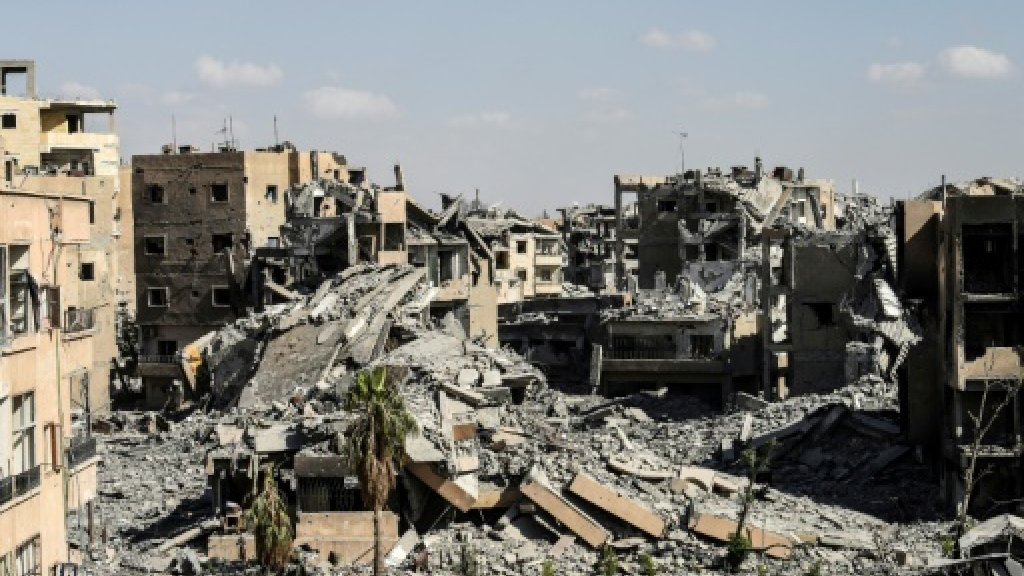 Convoy to leave Syria's Raqa under evacuation deal: coalition