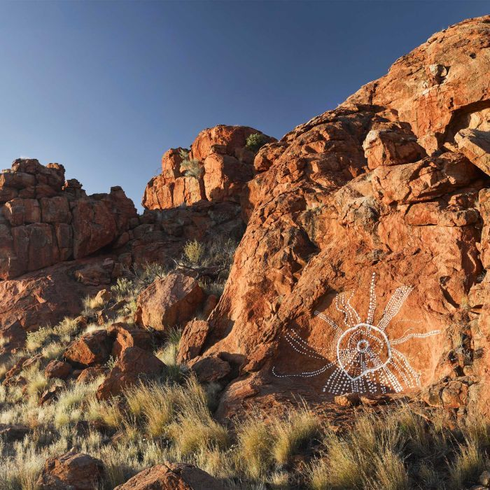 Indigenous artists from APY Lands use ancient techniques to create new rock art