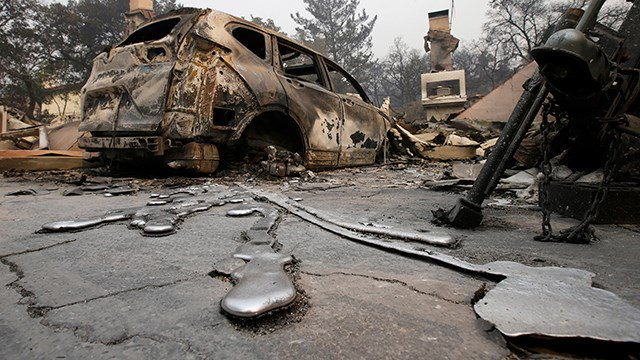 Slideshow: Wildfires ravage California, melting cars, destroying