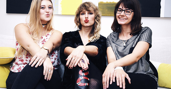 Taylor Swift rocked some snake boots as she listened to her upcoming album with fans: