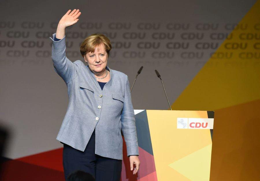 Merkel in poll setback before tough coalition talks