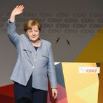 Merkel in poll setback before tough coalition talks