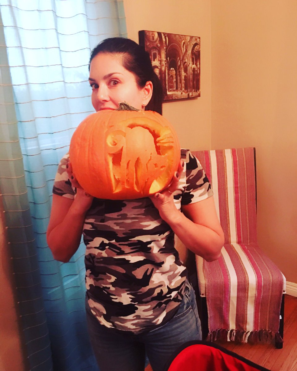Spooky Halloween is coming! Nisha's first pumpkin carving. She emptied it out and I carved this spooky