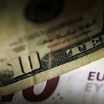 Euro on defensive on political worries, tame inflation dents dollar