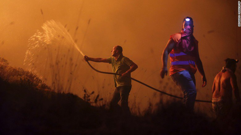 At least 34 people have been killed by wildfires in Portugal and Spain