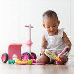 Babies can learn the value of persistence by watching grownups stick with a challenge