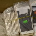4 men arrested over counterfeit mobile phones
