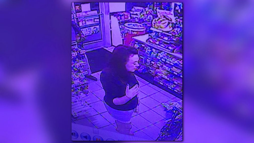 Police: Woman stole credit card as store clerk had seizure