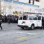 Police officer pulls gun, says 'Who wants a bullet?' at haredi protest