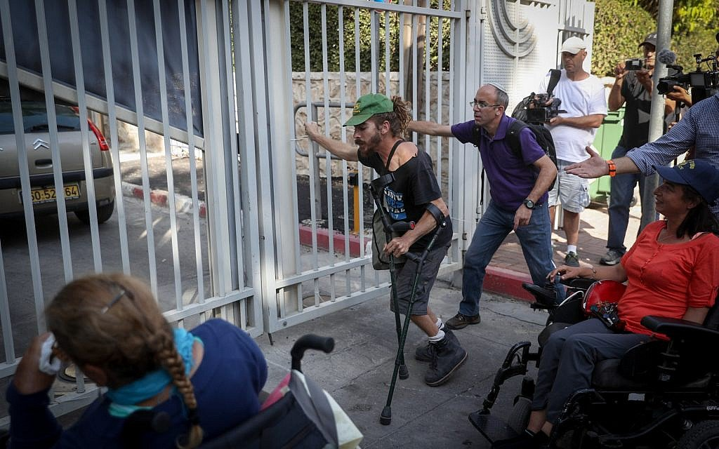 Disabled protesters demonstrate outside PM's residence