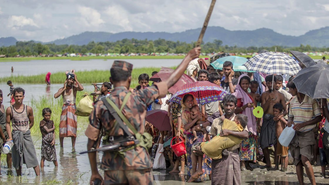 The Latest: Amnesty says Myanmar killed 100s of Rohingya
