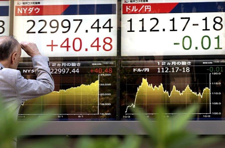 @BroadcastImagem: De olho em evento na China, bolsas asiáticas fecham perto da estabilidade. Eugene Hoshiko/AP