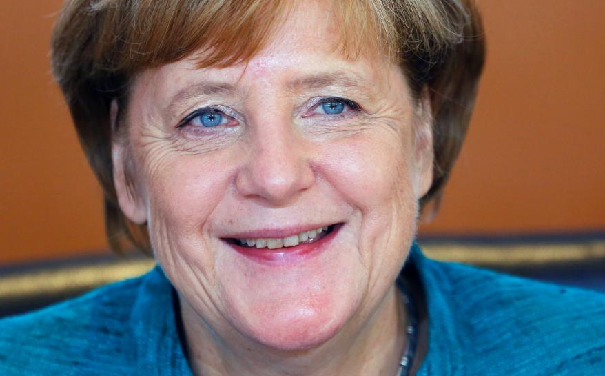 Weakened Merkel warns of compromise as talks on coalition start