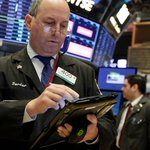 Dow ends above 23,000 for first time on strong IBM earnings