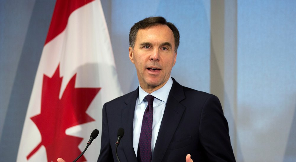 Bill Morneau slammed for using 'loophole' to avoid placing shares in blind trust