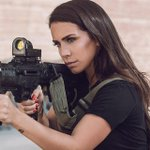 A female Israeli combat soldier proudly models for weapons companies