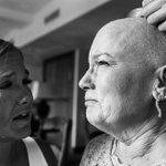 The inspiring story behind incredible candid wedding photo of crying bride and her courageous mum