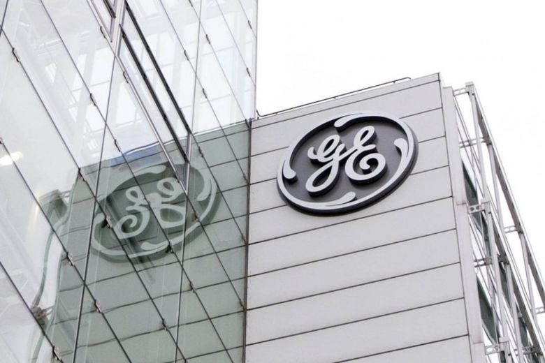 GE shares plunge as it cuts profit forecast