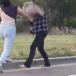 Two women have bizarre road rage brawl where they rip each other's clothes off in the middle of a busy highway