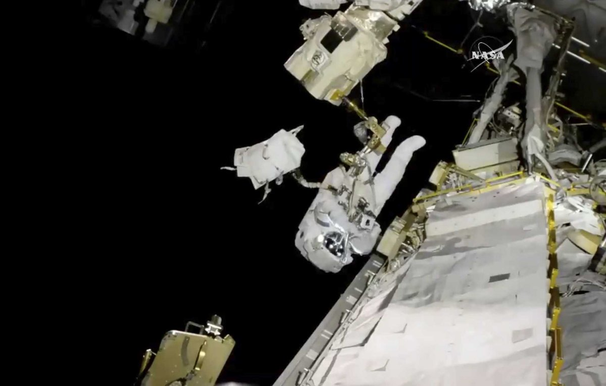 Spacewalking astronauts replace blurry camera on robot arm