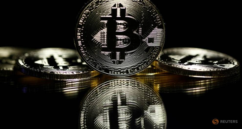 Bitcoin soars to record high above US$6,000
