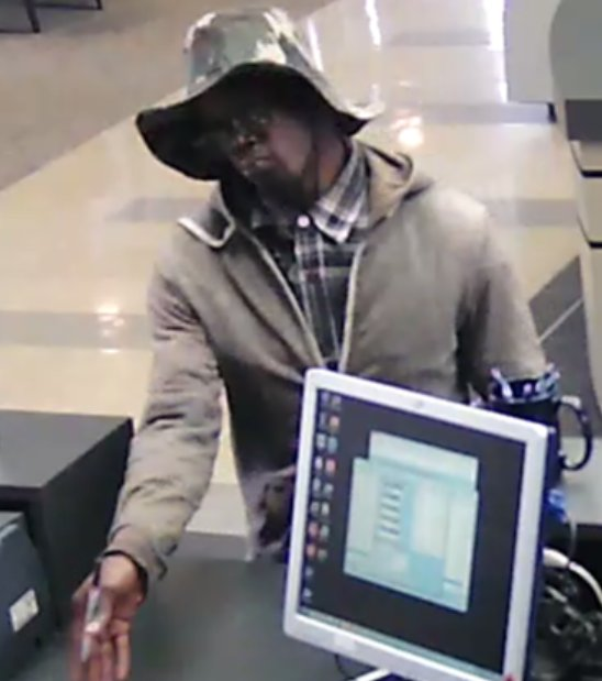 test Twitter Media - IMAGES: FBI investigators have released these images of the man suspected of robbing the Arvest Bank on US-40 Hwy. https://t.co/Oogv10hrlQ https://t.co/NGayvjaght