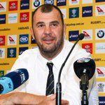 Wallabies coach Michael Cheika resists a return serve at Nick Farr-Jones