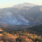 Crews fighting brush fire caused by possible plane crash