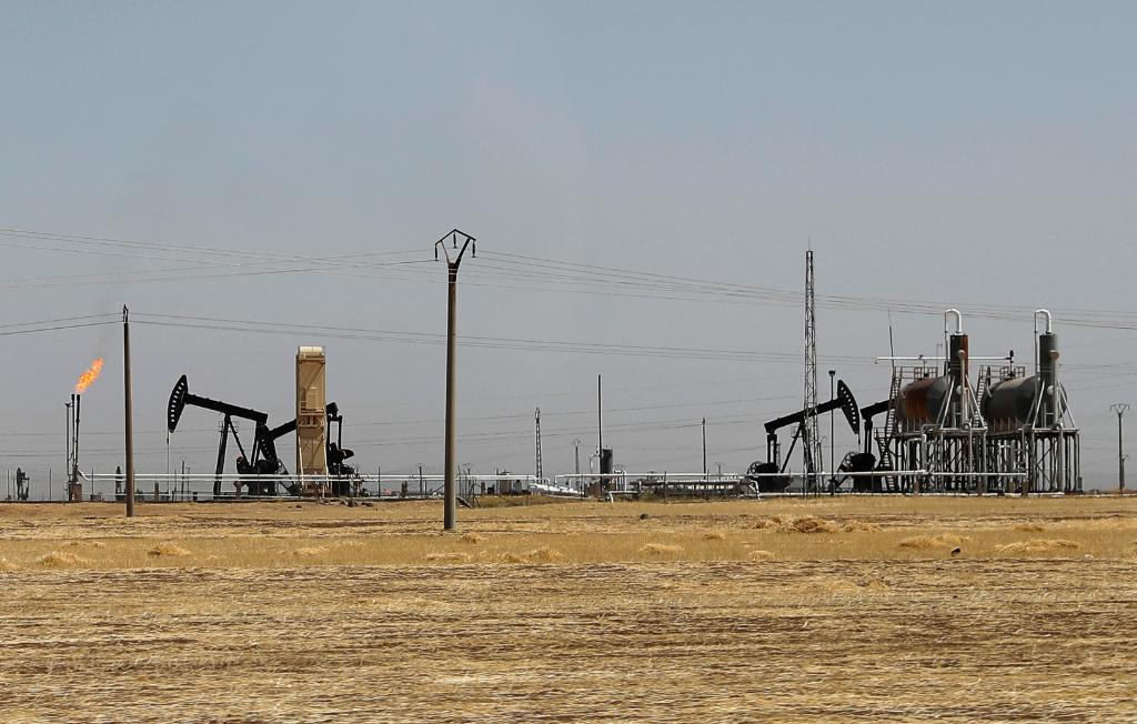 The U.S.-led coalition says allied fighters captured Syria's largest oil field from ISIS: