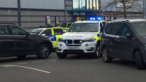 Gunman takes hostages at UK bowling alley, owner says, as police rule out terror