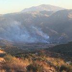 Crews extinguish brush fire caused by possible plane crash