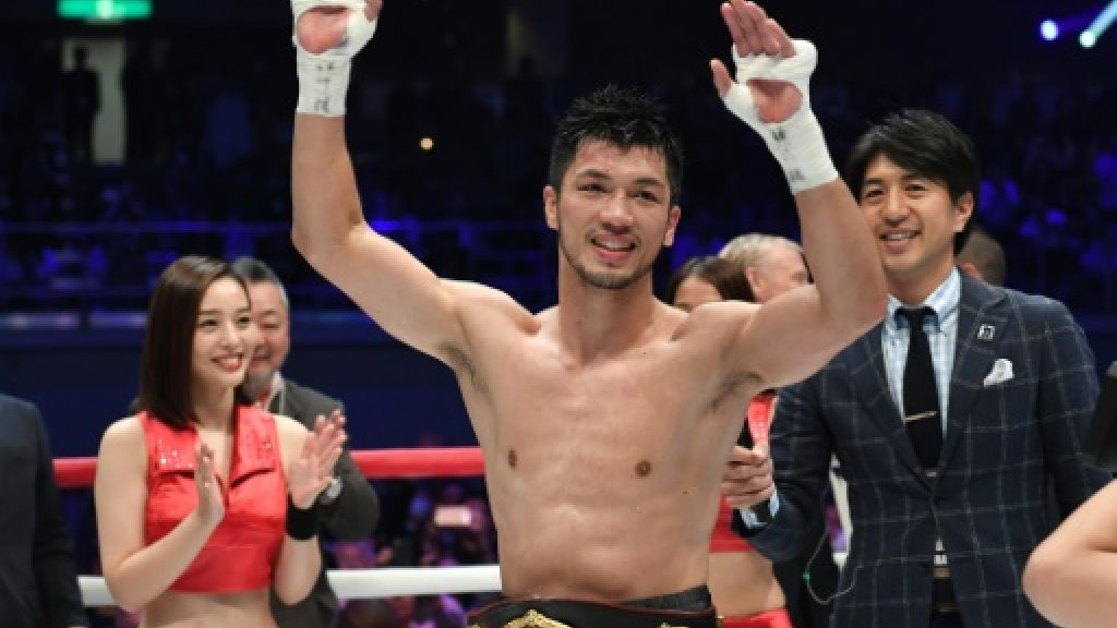 Boxing: Japan's Murata stops N'Dam to win world title
