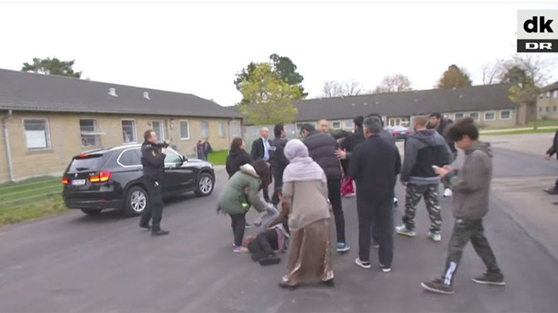 Danish immigration minister flees deportation center chased by angry migrants (VIDEO)