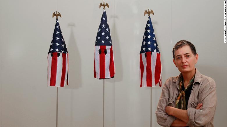 Professor's artwork uses US flags to make KKK-stylehoods