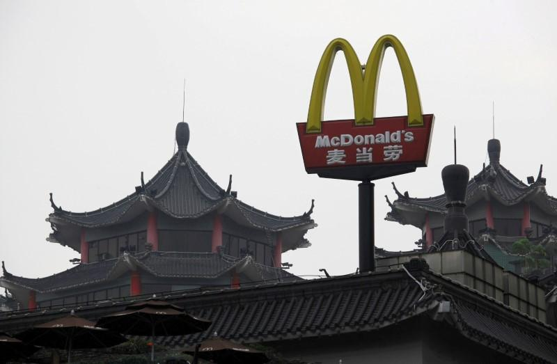 'Golden Arches': McDonald's gets new China name following unit sale