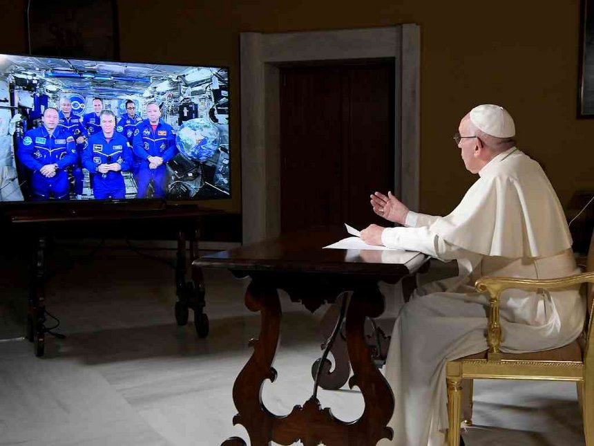 Pope Francis admires peace of space in video call with astronauts