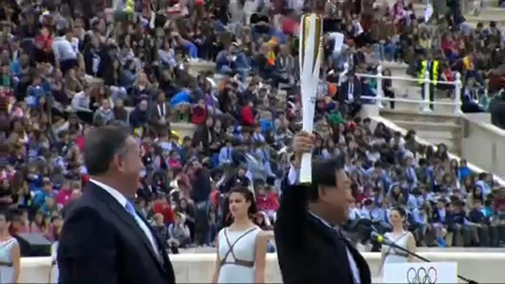 Greece hands over Olympic torch to South Korea
