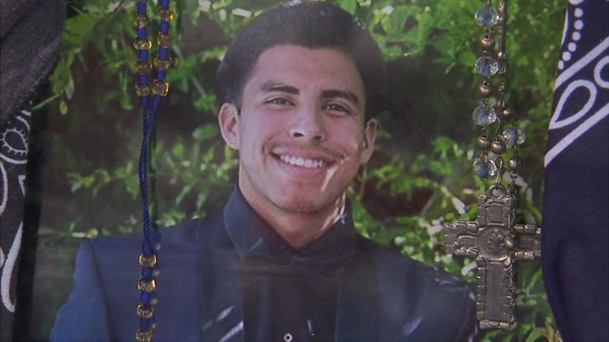 Boy, 14, arrested in gang territory shooting death of college student not in gang