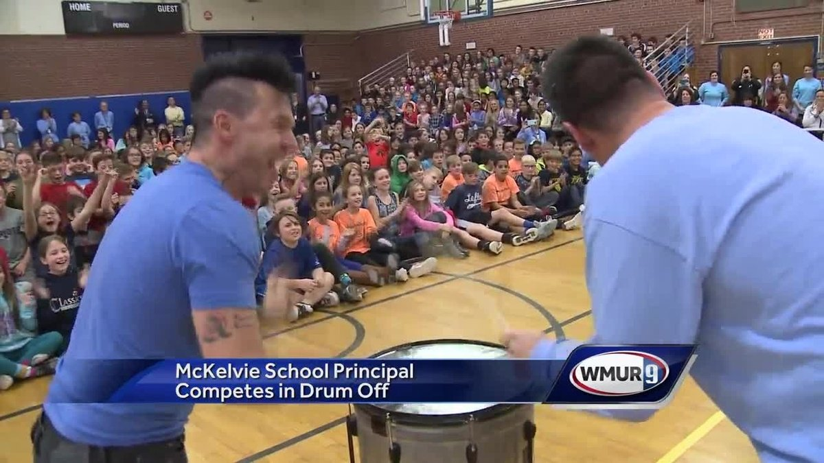 McKelvie School principal competes in 'drum-off' against Recycled Percussion