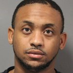 Dover Police charge 2 following traffic stop: 1 with a gun, the other a fugitive