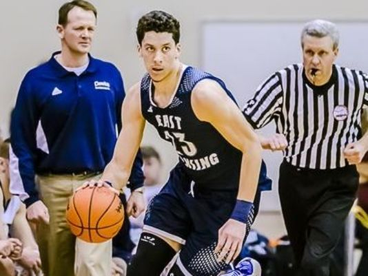 East Lansing's Brandon Johns signs with Michigan