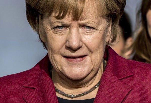 German parties seek compromise on migrants, climate change