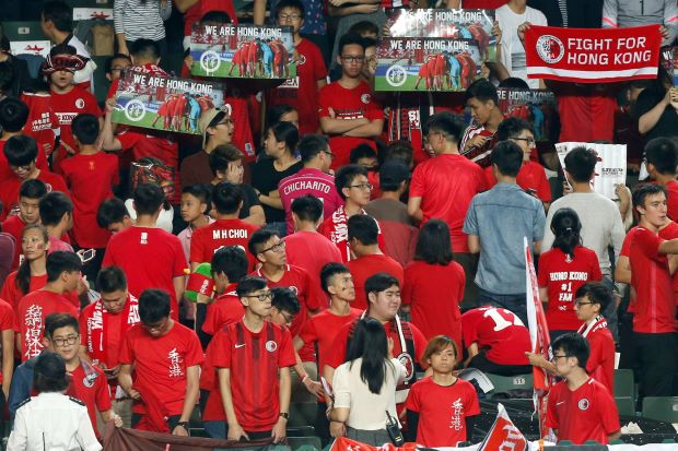 Hong Kong football fans defy Beijing by booing Chinese national anthem