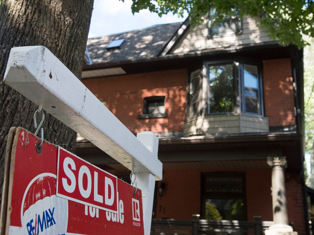 Canadian home sales edge up in October, but prices fall amid mortgage rule changes