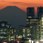 Japan's economy continues growth spurt but pace slows