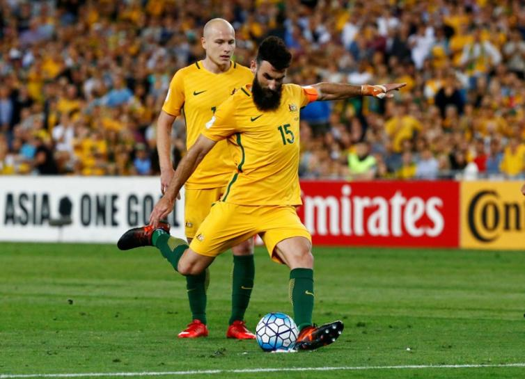 Jedinak hat-trick sends Australia to World Cup soccer