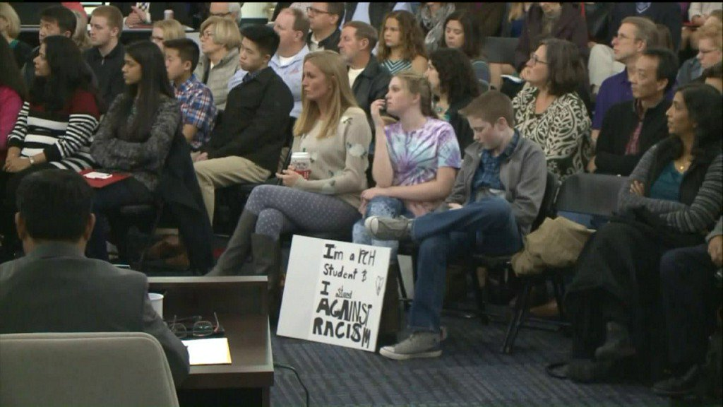 Parents and Community Activists address racist slur found written in girl'sbathroom