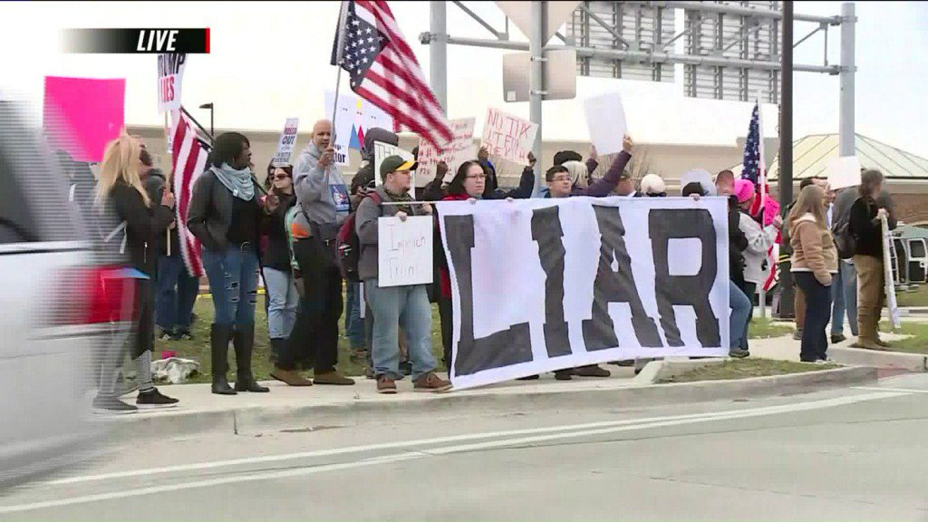 Supporters and protesters gather before President Trump visits St. Charles