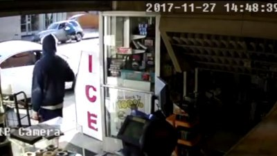 Surveillance video captures terrifying carjacking after driver leaves enginerunning