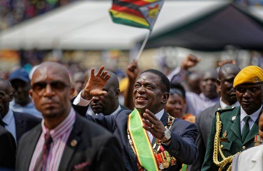 Zimbabwe's new leader appoints Cabinet; ruling party favored